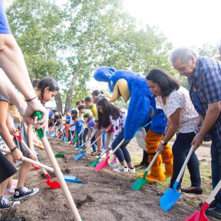 Attendees turn dirt at the Govalle groundbreaking