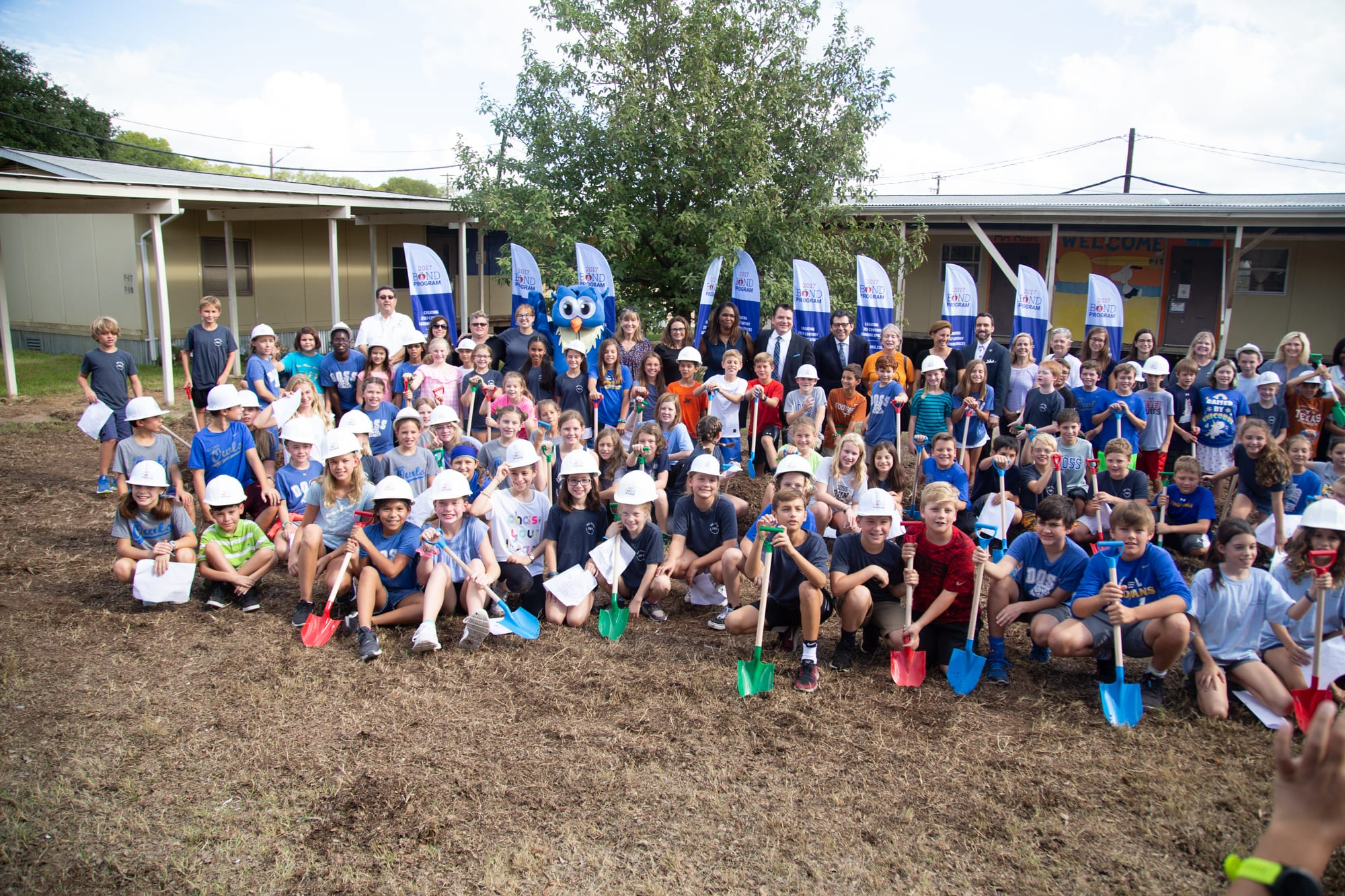Fifth grade students take part in the groundbreaking ceremony for the Doss Elementary School modernization