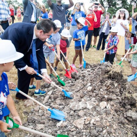 Dr. Cruz join Menchaca students to break ground