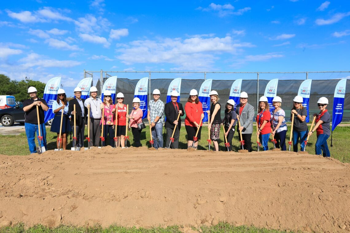 Austin ISD staff break ground at Bowie High School to celebrate the beginning of the construction for the new modernization project.